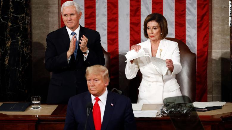 Speaker Nancy Pelosi tears her copy of President Donald Trump's State of the Union address after he delivered it to a joint session of Congress on February 4, 2020.